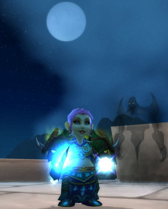 Tellisa, the pink-haired gnome Priest, and her ghostly companion standing on top of the walls of Stormwind